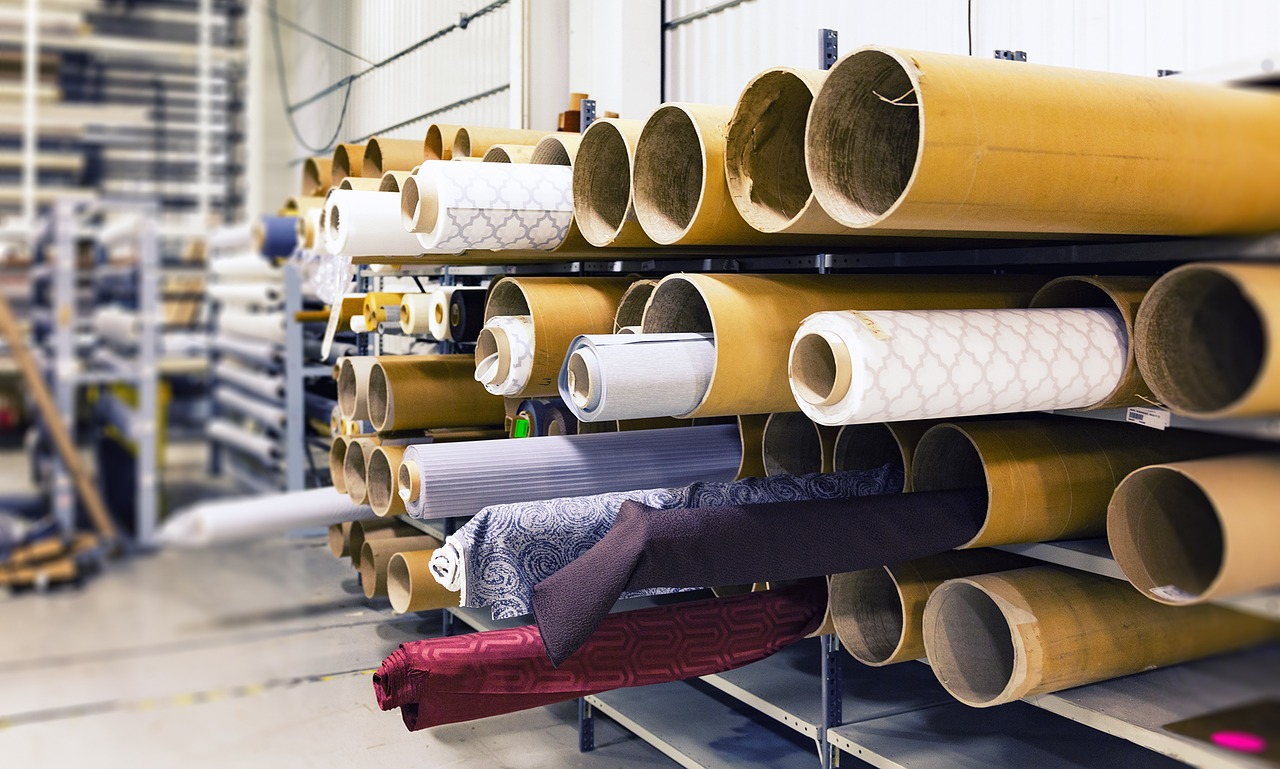 Rolls of colorful fabric, a component of direct materials for manufacturing cost.