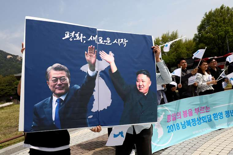 Posters of South Korean President Moon Jae-In and North Korean leader Kim Jong-Un during a rally on April 26, 2018 in Seoul. Credit: Chung Sung-Jun/Getty Images.