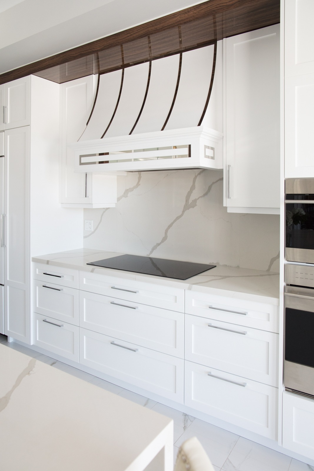 White Range Hood with Stainless Steel Accents