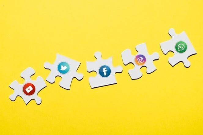 Social media icon on white puzzle piece on yellow background