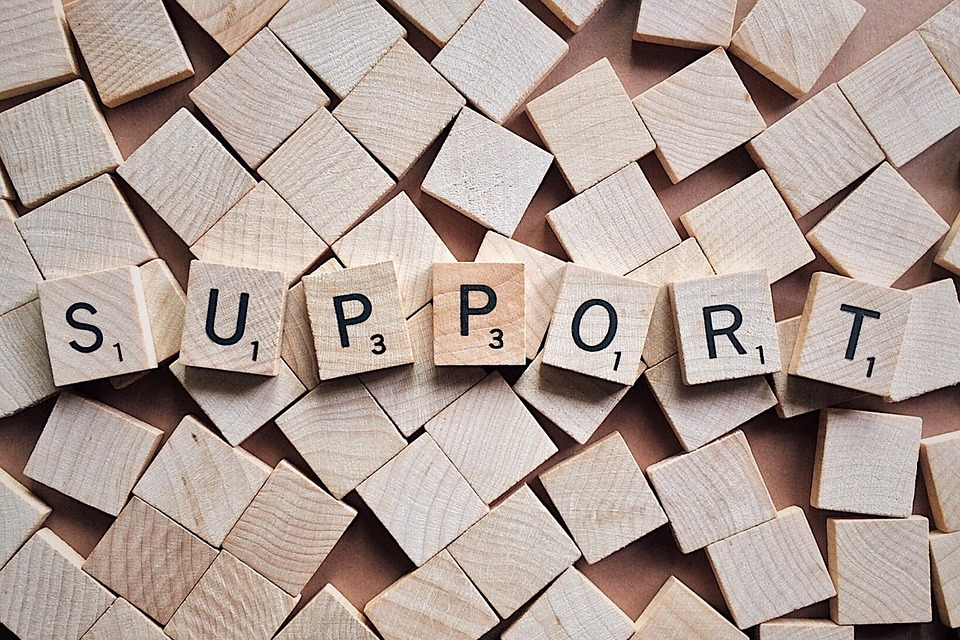 "The word ""Support"" written in scrabble tiles"