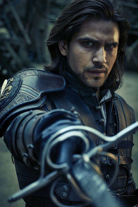 D'Artagnan in The Musketeers. I love this pose; his eyes are full of brooding while his sword arm is poised in patient readiness.: