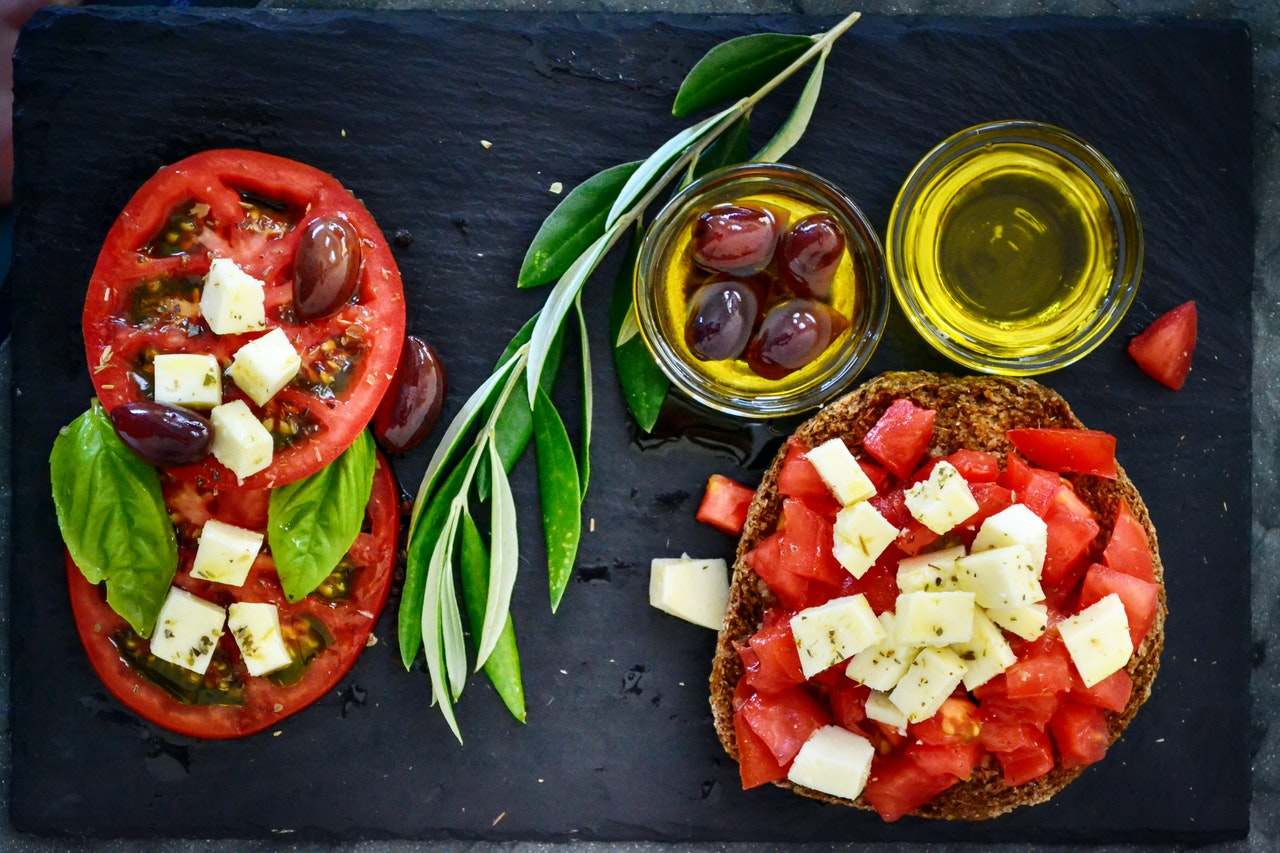 Mediterranean diet ingredients like olives, cheese, tomatoes and olive oil