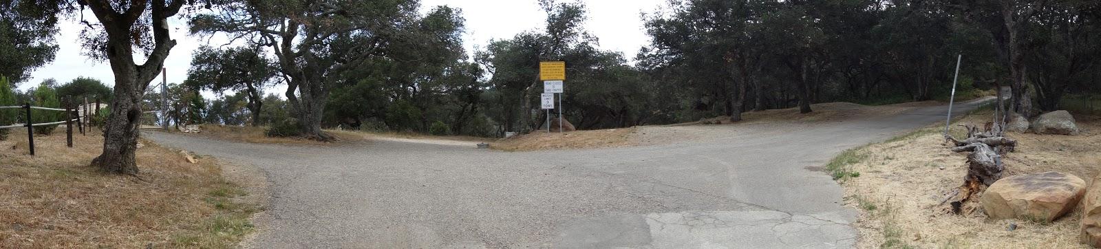 Riding bike up Refugio Road - pano of Refugio Pass and road sign