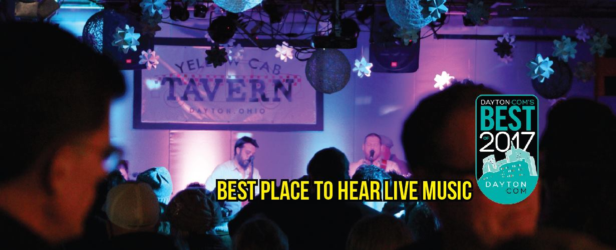 """band playing inside Yellow Cab Tavern, with text that reads """"BEST PLACE TO HEAR LIVE MUSIC"""""""