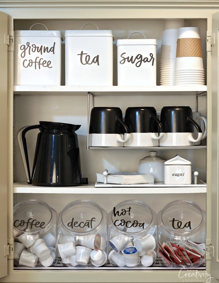 open cabinet with coffee bar accessories organized with farmhouse sticker labels