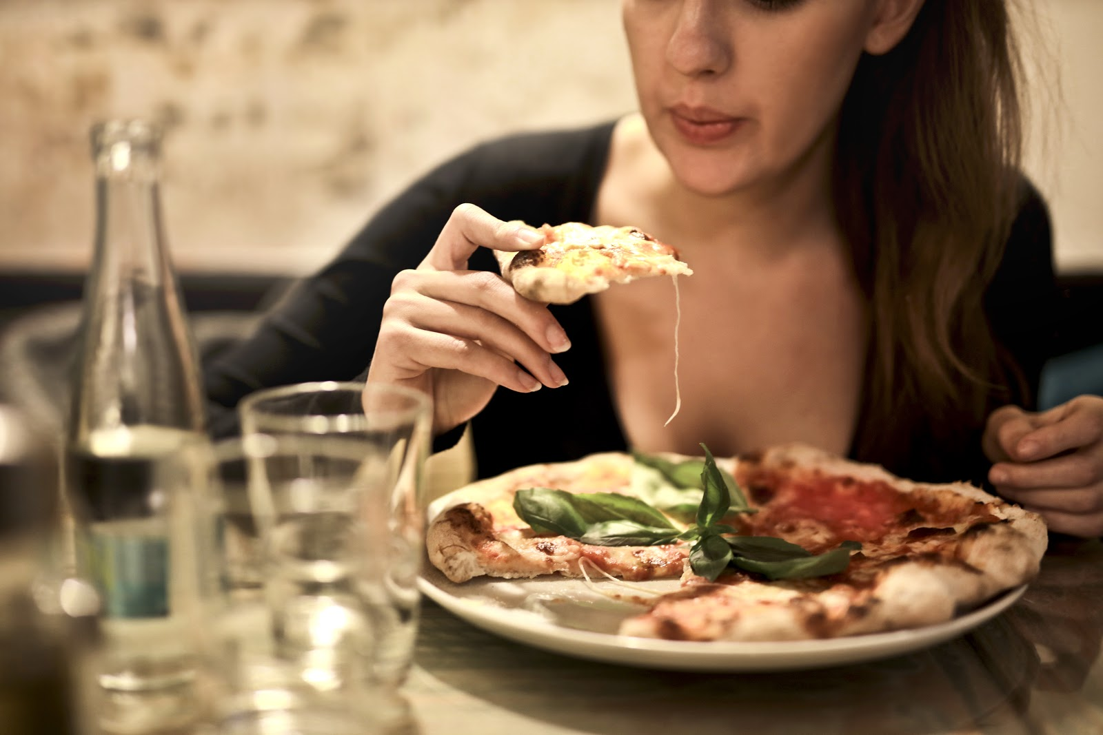 girl eating a pizza slice