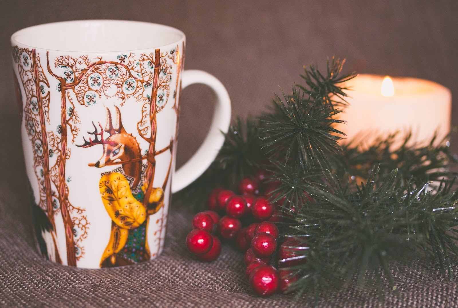 Christmas mug, wreath and candle