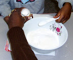 Children learn about measurement as they make play dough in preschool.