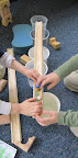 Children built a structure by following their drawn plan.