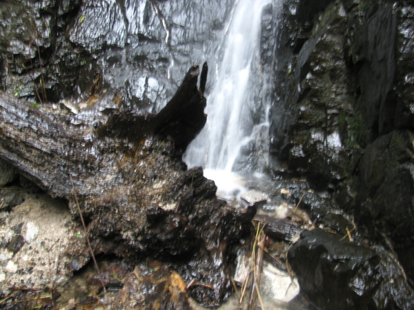 The bottom of the waterfall with water splashing everywhere.