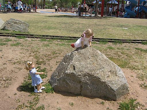 Kirsten climbs a small boulder.
