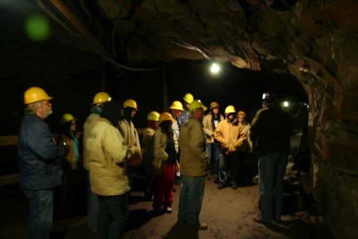 This photo demonstrates the lighting in the Quincy Mine using modern electricity. Before the use of electricity, workers used candle lighting. If in an event of the lighting going out workers would either have to stay in the mine or try to find a way out, which resulted in many injuries of falling through shafts, etc. The principle later became lawsuit frenzy against the mining companies on personal injury claims.-Ashley Holloway