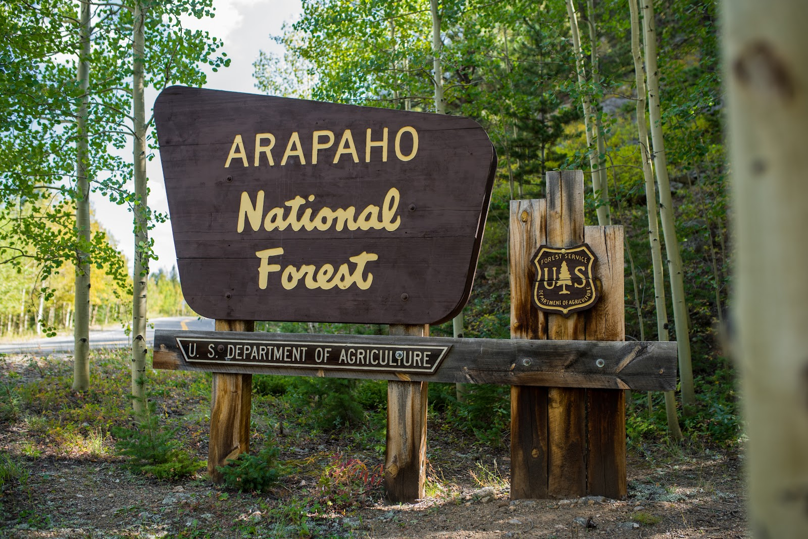 Arapaho National Forest sign on Hwy 103 while riding by bike to Mount Evans, Rocky Mountains