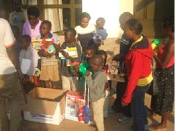 Ugandan orphans receive gifts of toys sent by families in the UK