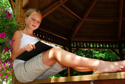 Reading a book in a gazebo