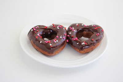 photo of two chocolate donuts on a plate