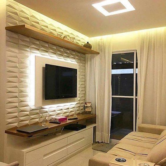 Painel 3D cimentício como painel de TV, hack branco e sofá creme.