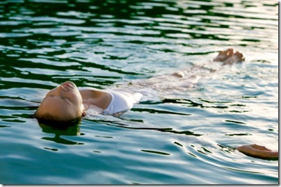 woman floating on the water