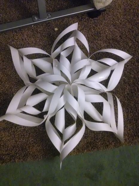 A 3-d paper snowflake made by twisting and stapling paper.