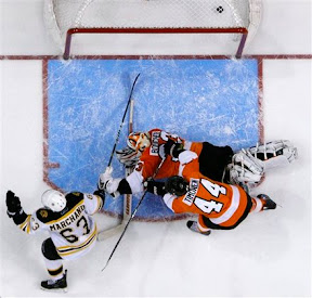 Brad Marchand scores the eventual game winning goal against the Flyers