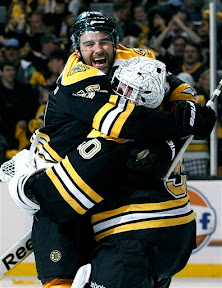 Bruins Johnny Boychuk and Tim Thomas celebrate the Bruins sweep of the Flyers to win the series