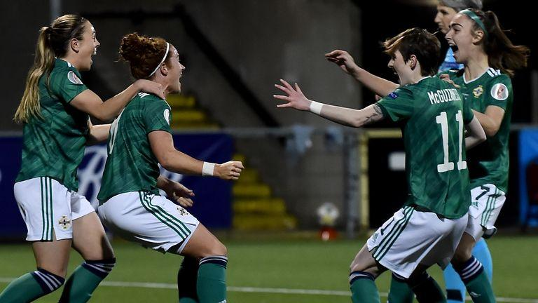 BELFAST, NORTHERN IRELAND - APRIL 13: Marissa Callaghan of Northern Ireland celebrates with teammates after scoring their team's first goal during the UEFA Women's Euro 2022 Play-off match between Northern Ireland and Ukraine at Seaview on April 13, 2021 in Belfast, Northern Ireland. Sporting stadiums around the UK remain under strict restrictions due to the Coronavirus Pandemic as Government social distancing laws prohibit fans inside venues resulting in games being played behind closed doors.