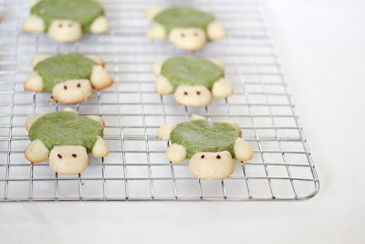 photo of sugar cookie turtles on a baking rack