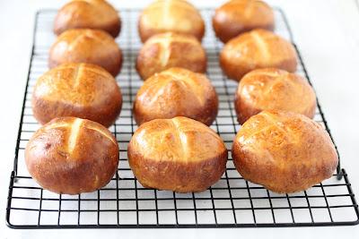 pretzel rolls cooling on a baking rack