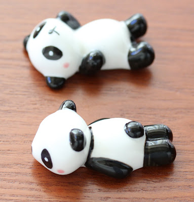 photo of two panda bear chopstick holders