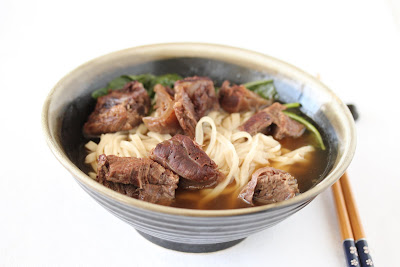 beef noodle soup with chopsticks