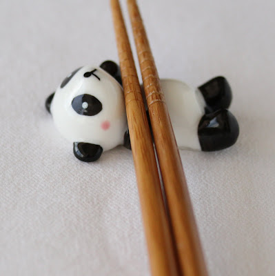 photo of chopsticks in a panda bear shaped holder