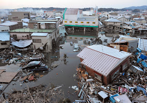Buildings swept by a tsunami following an earthquake are seen in Miyagi Prefecture on March 12, 2011.