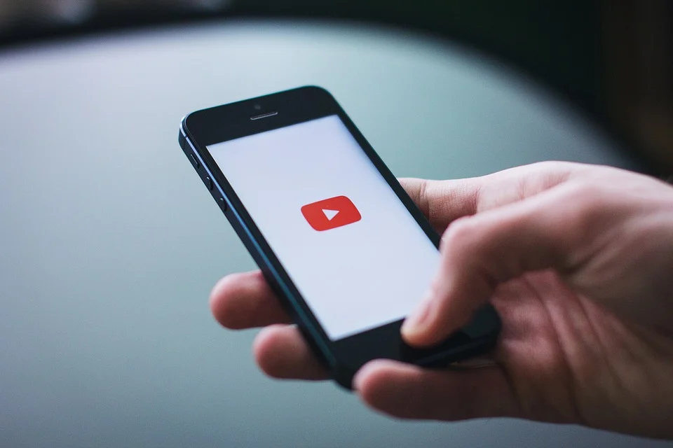 cell phone displaying the YouTube app
