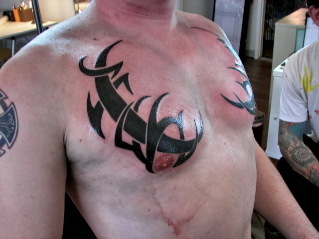 tribal tattoos for men on chest. chest tattoos for men. Tribal