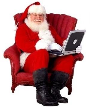 papai noel com laptop no colo