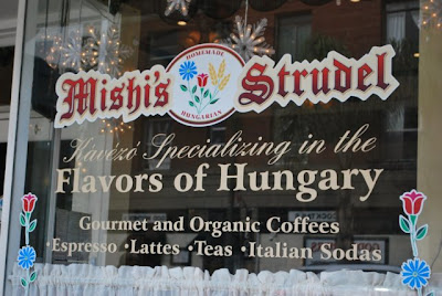 This is a photo of Mishi's Cafe store front window in Port San Pedro, CA.