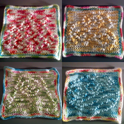 picture of four crocheted towels, each in a different color and with a different bending symbol on it in raised knots
