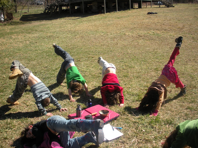 ThumbsUp Kids doing a Downward Facing Dog variation
