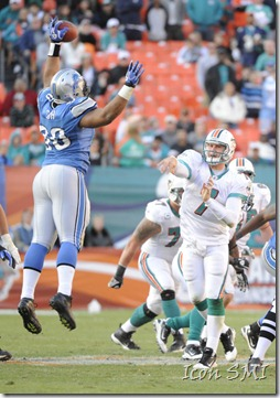 NFL Rookie of the Year, Detroit Lions defensive tackle Ndamukong Suh, bats down a pass thrown by Miami Dolphins quarterback Chad Henne.
