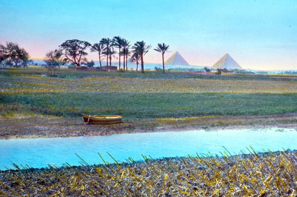 Image of Colour photograph of the River Nile in Giza, Egypt. The Pyramids can be seen in the distance. Dated 1910, © Universal History Archive/UIG / Bridgeman Images