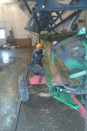 Working on the grain table.  This is a 30 foot grain head that we use to combine wheat and soybeans.  Wheat will be ready soon after we are finished planting so its important to make sure that everthing is ready to go to minimize the amount of down time when the conditions are fit.