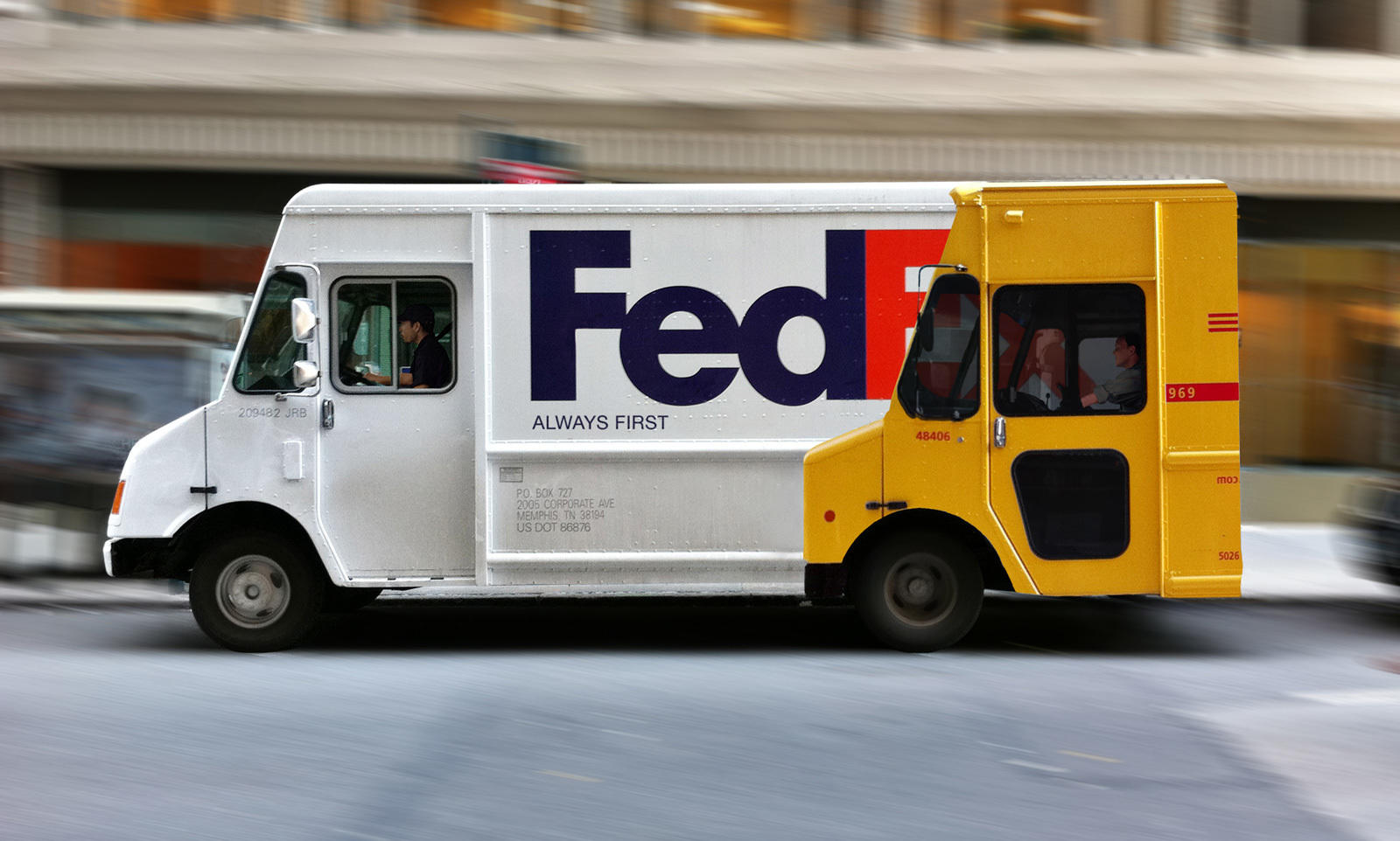 FedEx truck with vinyl of another mailing service, indicating they are faster