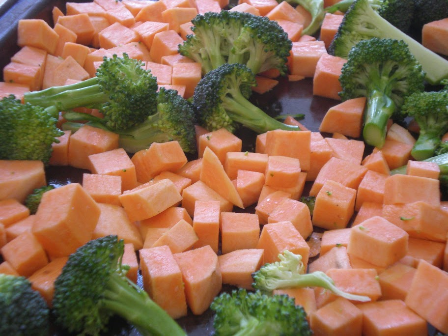 Broccoli and sweet potato cut to size so that they are both done in fifteen minutes spent in a 475F oven.