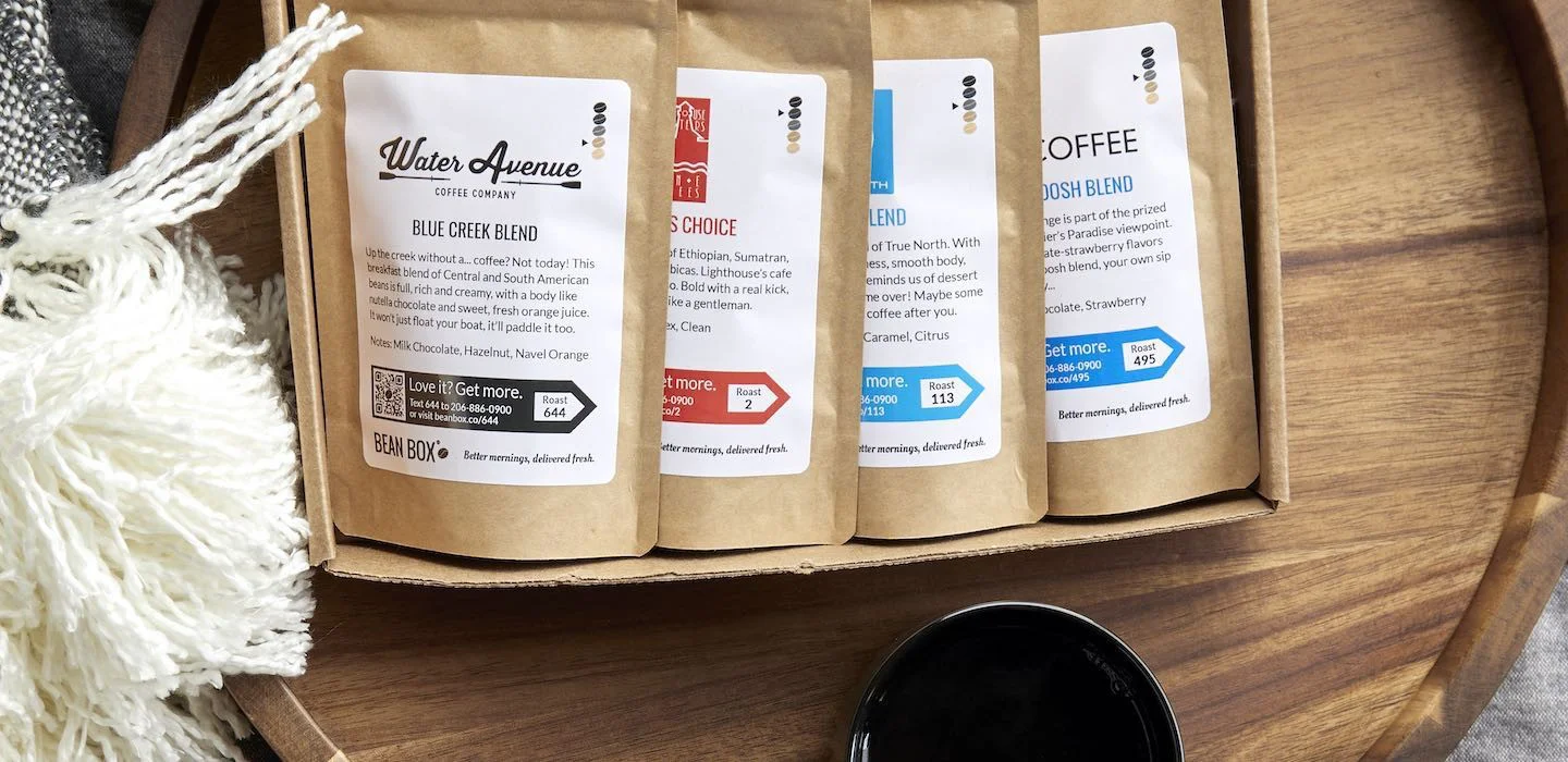 Photo of four different coffees in a subscription box from Bean Box