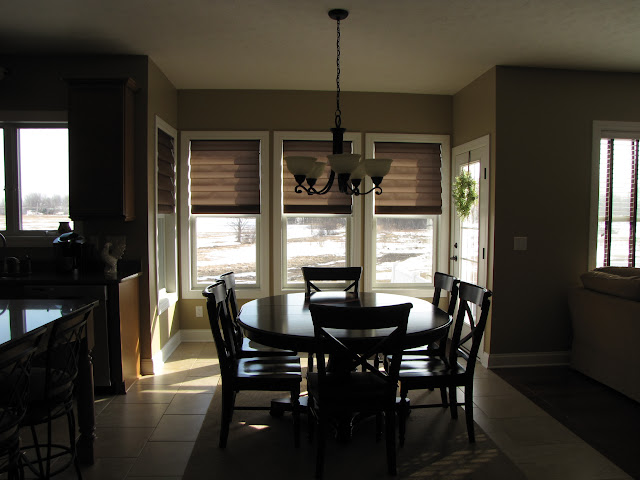 Here Are Some Photos Of My Kitchen Should I Try To Match Bamboo Shades Cabinet Color Table Or The Rug Under