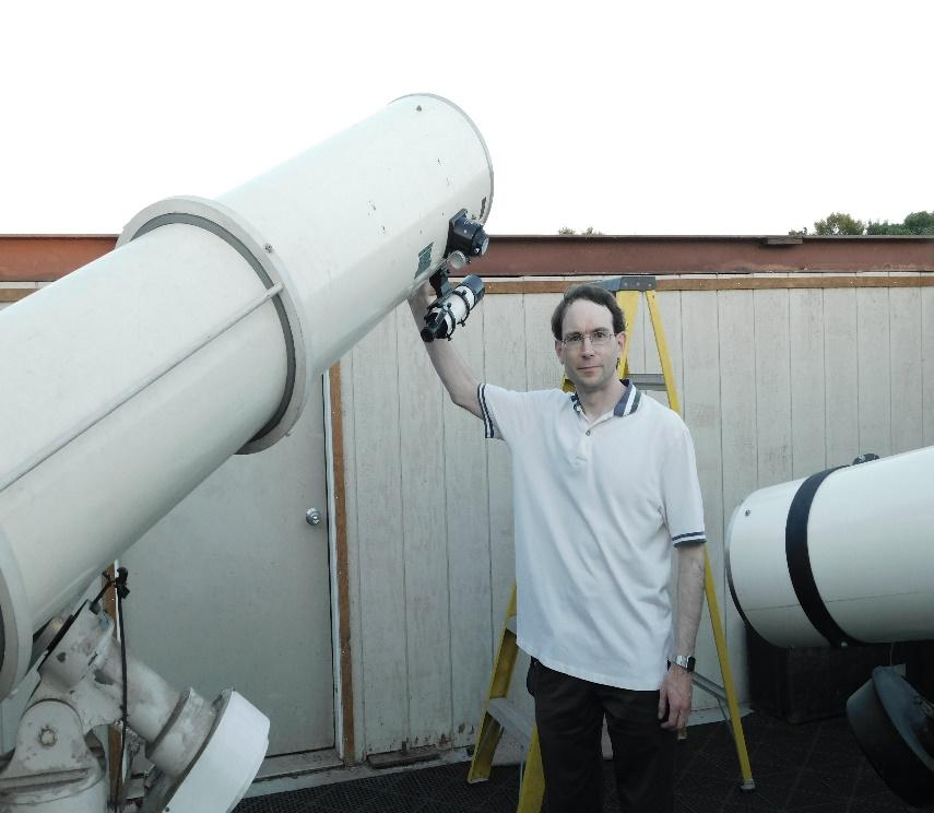 A picture containing telescope, man, object, plane