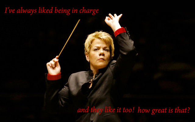 Secret 8 - Image: A woman conducting an (offscreen) orchestra. Text: I've always liked being in charge and they like it too! how great is that? Font: serif.