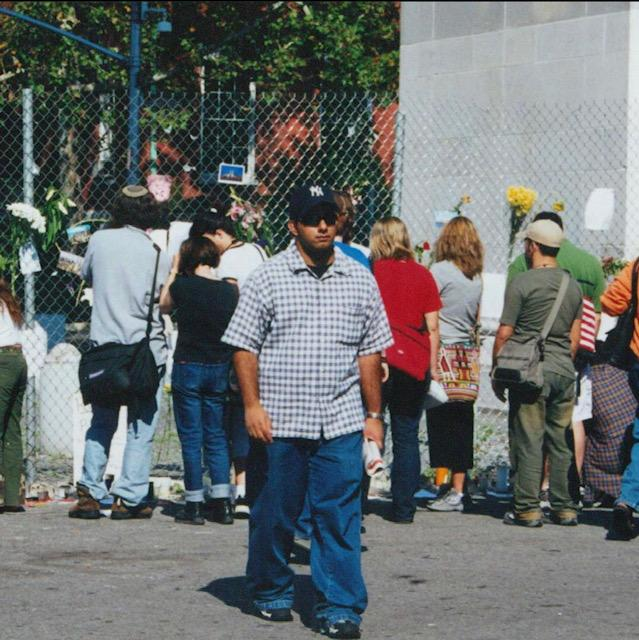 A person standing in front of a crowd of people  Description automatically generated with low confidence