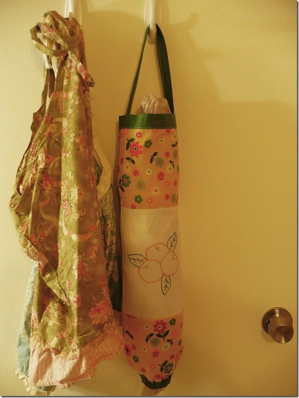 a fabric plastic bag holder on a closet door